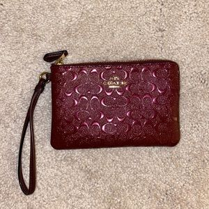 Coach great condition wristlet in burgundy